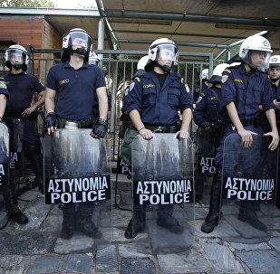 Riot police stand guard the entrance of ancient Acropolis site in Athens