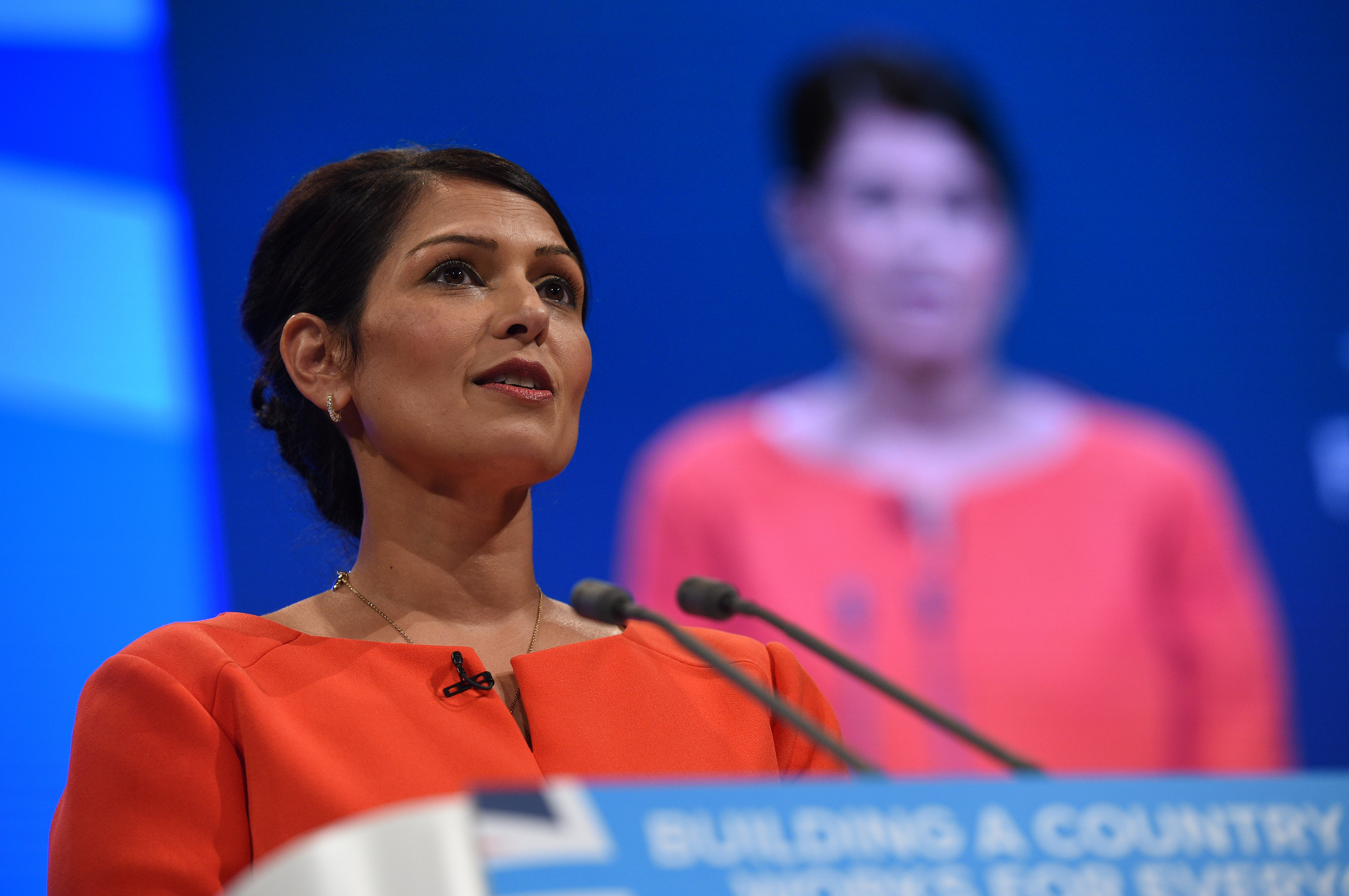 Britain's International Development Secretary Priti Patel delivers her speech on the third day of the Conservative Party annual conference at the Manchester Central Convention Centre in Manchester on October 3, 2017.