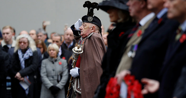 Attendees and members of the Western Front Association observe two minutes silence at the Cenotaph during a service to remember servicemen and women killed conflict, in London, Britain November 11, 2017