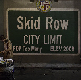 A homeless man takes food from a trash can in Los Angeles' Skid Row area, home to the nation's largest concentration of homeless people, Saturday, Oct. 28, 2017, in Los Angeles. At least 10 cities have declared official states of emergency, and California declared a statewide emergency due to a hepatitis A outbreak linked to homeless encampments. Comparisons are being made to conditions more commonly seen in Third World countries.