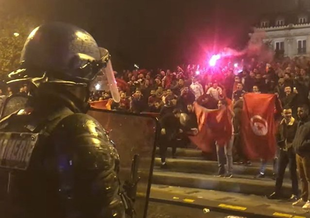Moroccan football fans revel at Champs-Élysées in Paris