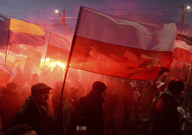 Demonstrators burn flares and wave Polish flags during the annual march to commemorate Poland's National Independence Day in Warsaw, Saturday, Nov. 11, 2017. Thousands of nationalists marched in Warsaw on Poland's Independence Day holiday, taking part in an event that was organized by far-right groups