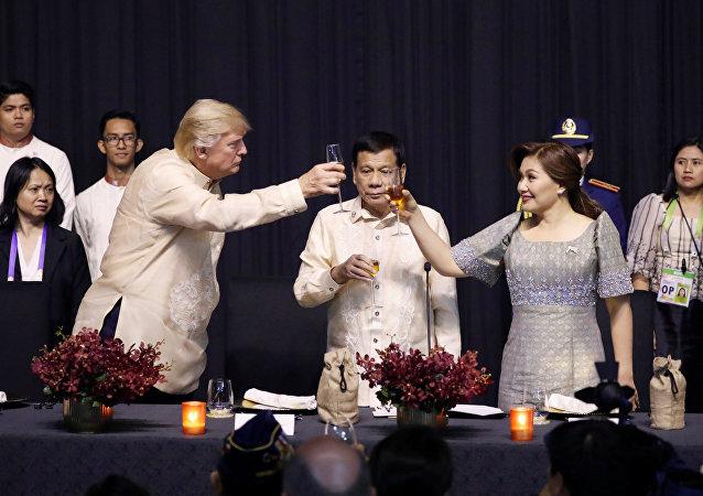 U.S. President Donald Trump toasts with Philippines President Rodrigo Duterte and Honeylet Avancena during the gala dinner marking ASEAN's 50th anniversary in Manila, Philippines November 12, 2017