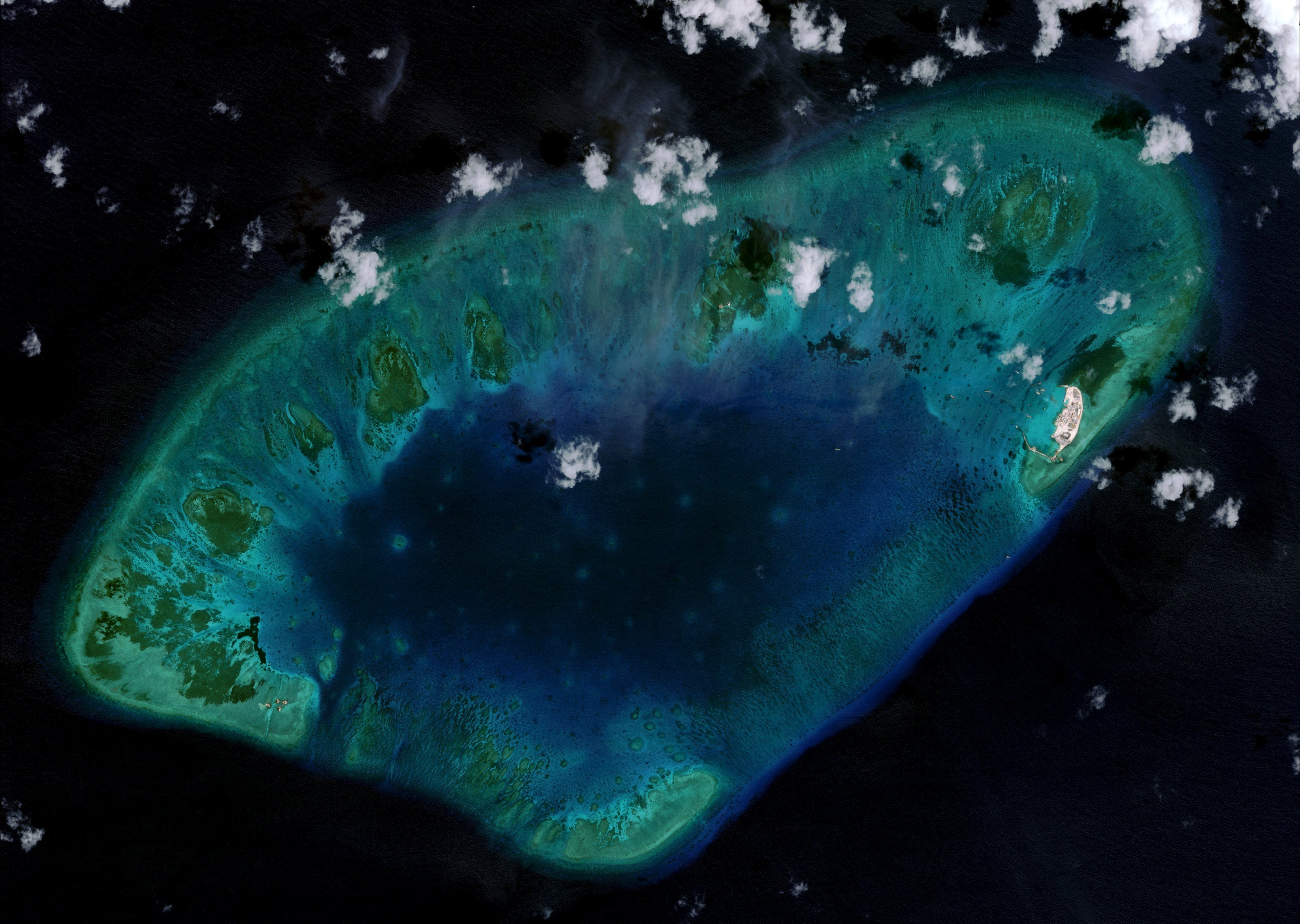 West London Reef is pictured in the South China Sea in 2015, in this handout photo provided by CSIS Asia Maritime Transparency Initiative/DigitalGlobe. New satellite images show Vietnam has carried out significant land reclamation at two sites in the disputed South China Sea, but the scale and pace of the work is dwarfed by that of China, a U.S. research institute said on May 7, 2015