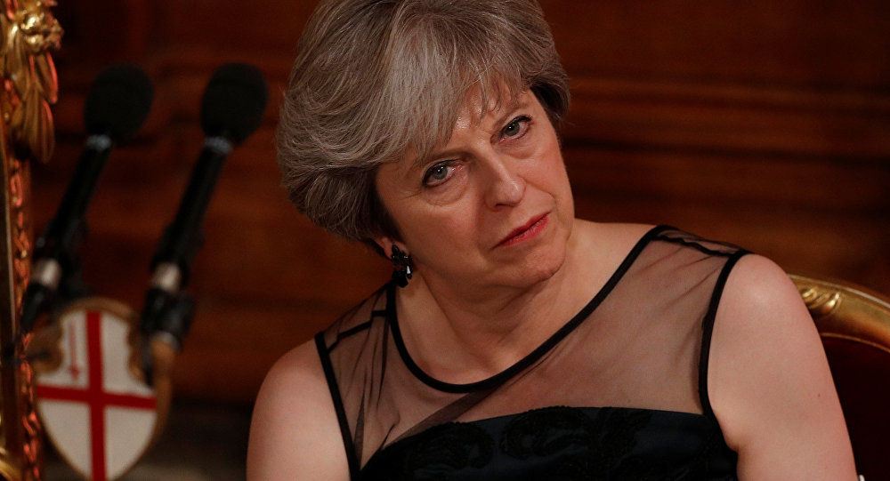 Britain's Prime Minister Theresa May listens to a speech at the Lord Mayor's Banquet at the Guildhall, in London, Britain November 13, 2017.