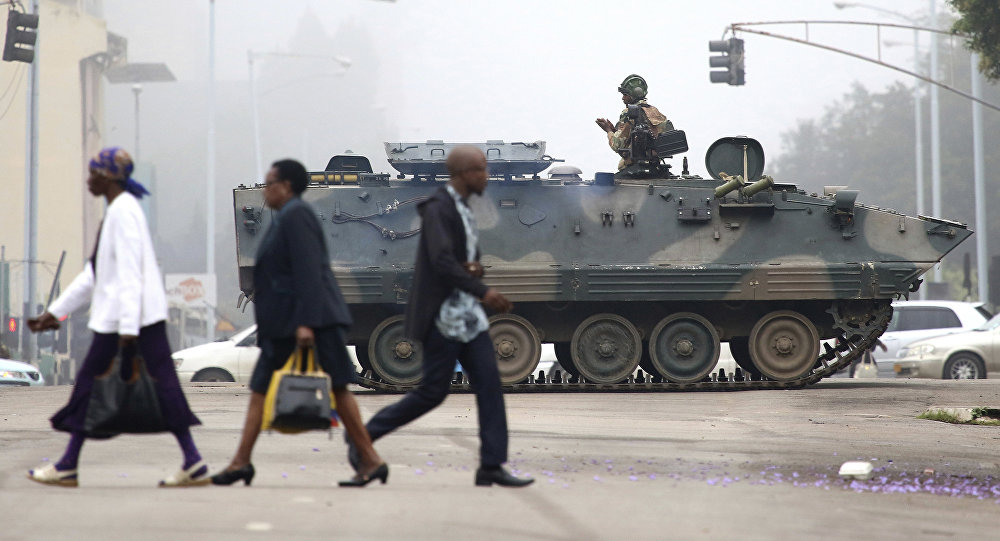 An armed soldier patrols a street in Harare, Zimbabwe, Wednesday, Nov. 15, 2017