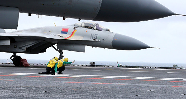 This photo taken on January 2, 2017 shows Chinese J-15 fighter jets on the deck of the Liaoning aircraft carrier during military drills in the South China Sea