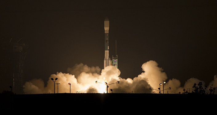 This photo provided by NASA, A Delta 2 rocket carrying the Soil Moisture Active Passive, SMAP ,satellite launches early Saturday, Jan. 31, 2015 from Vandenberg Air Force Base, Calif.