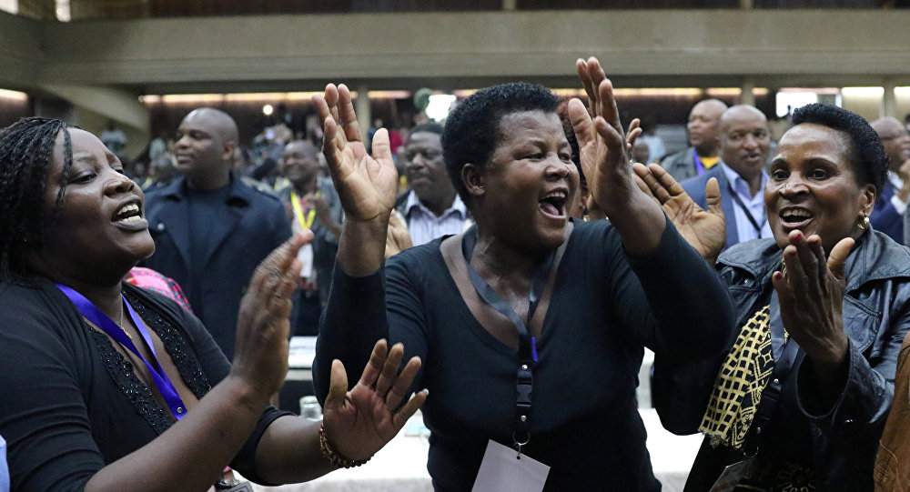 Delegates celebrate after Zimbabwean President Robert Mugabe was dismissed as party leader at an extraordinary meeting of the ruling ZANU-PF's central committee in Harare, Zimbabwe November 19, 2017