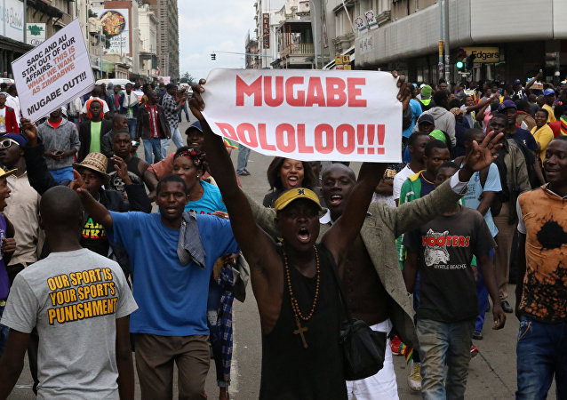 Protesters calling for Zimbabwean President Robert Mugabe to step down take to the streets in Harare, Zimbabwe November 18, 2017