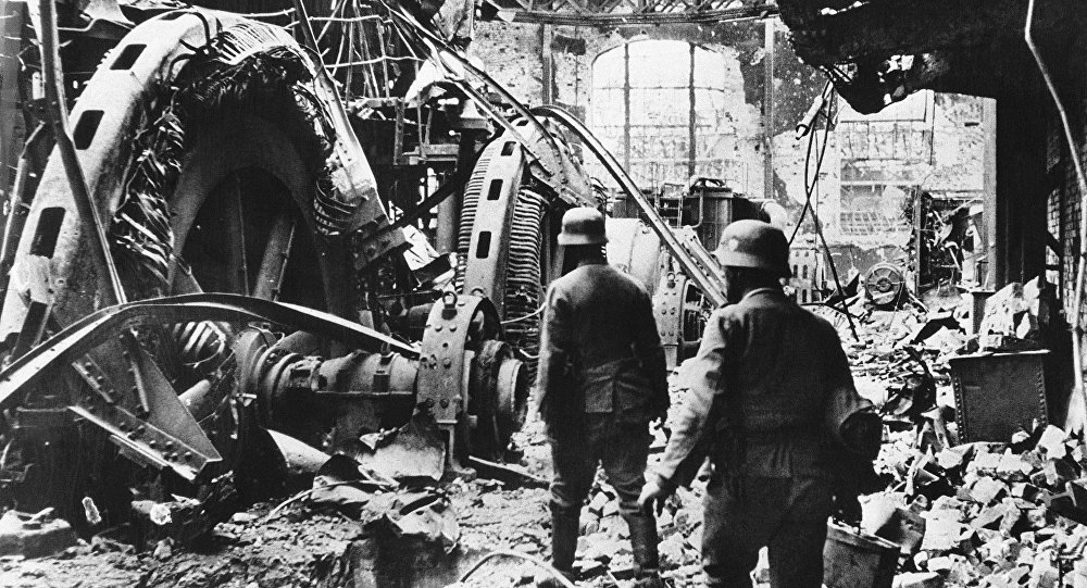 German troops passing through a wrecked generating station in the factory district of Stalingrad on Dec. 28, 1942
