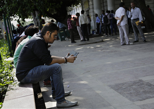 An Indian man uses his mobile phone in New Delhi, India. (File)