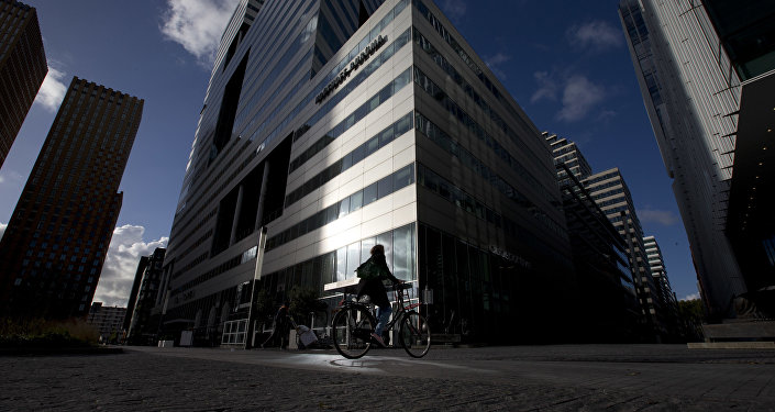 Sunlight is reflected off a building onto a bicyclist in Amsterdam's Zuidas, or southern axis, business district. Amsterdam has won the competition to be the host city of the European Medicines Agency, EMA, once it leaves London after Brexit (File)