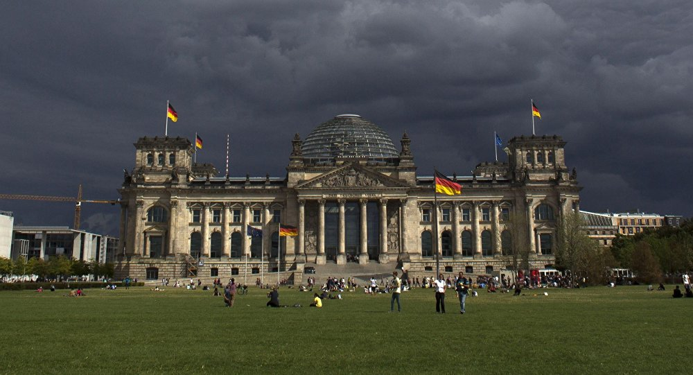 Dark clouds hang over the Reichstag, the German parliament Bundestag building, in Berlin