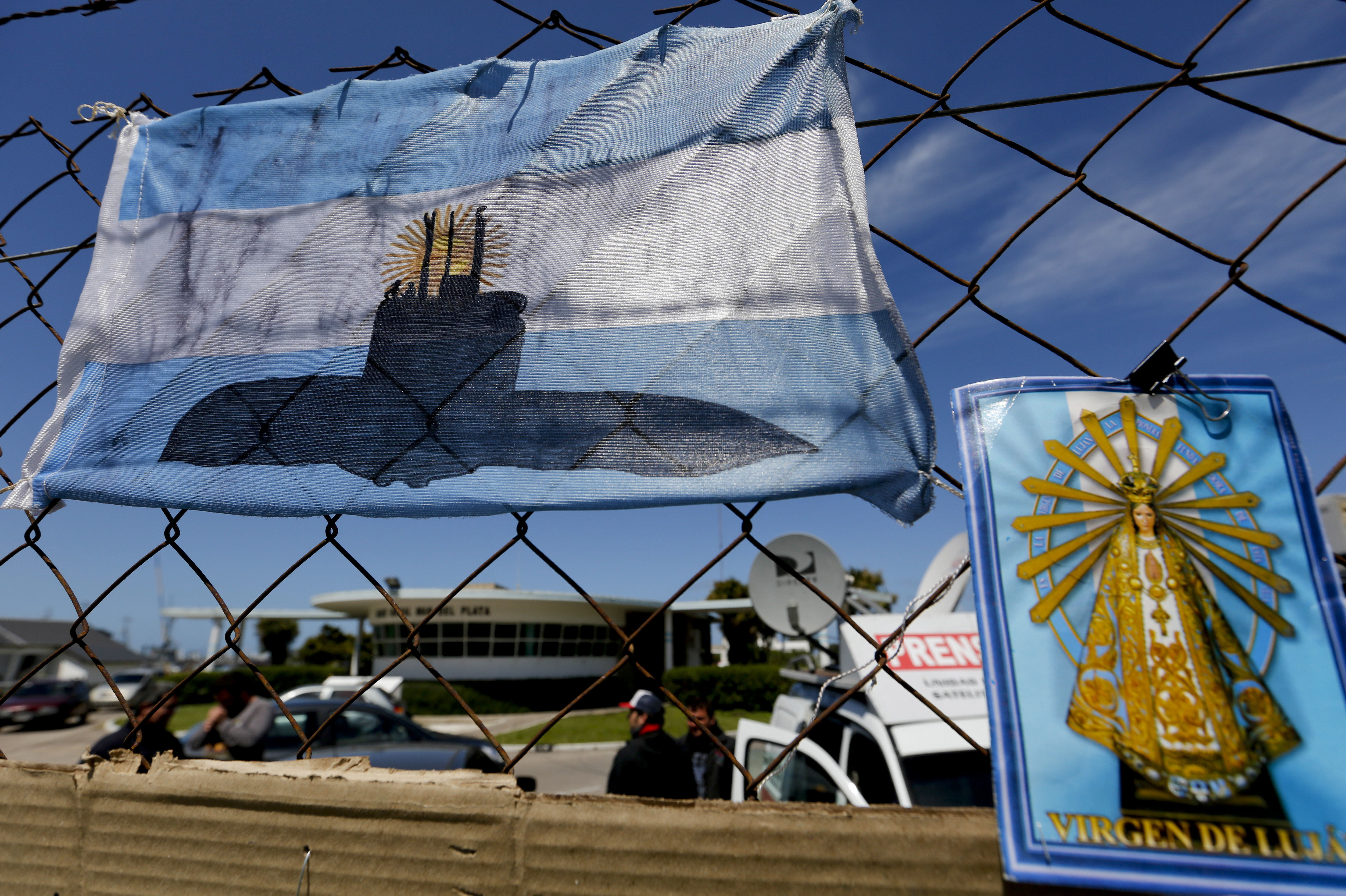 An Argentine national flag with a drawing of a submarine hangs from the fence surrounding the naval base in Mar del Plata Argentina Tuesday Nov. 21 2017