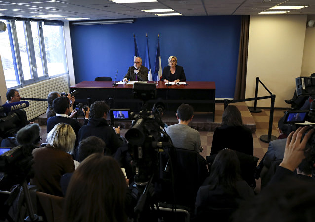 French far-right Front National (FN) party president Marine Le Pen (R), flanked by FN party member Wallerand de Saint-Just (L), speaks during a press conference focused on French democracy threatened by financial oligarchies, on November 22, 2017, in Paris