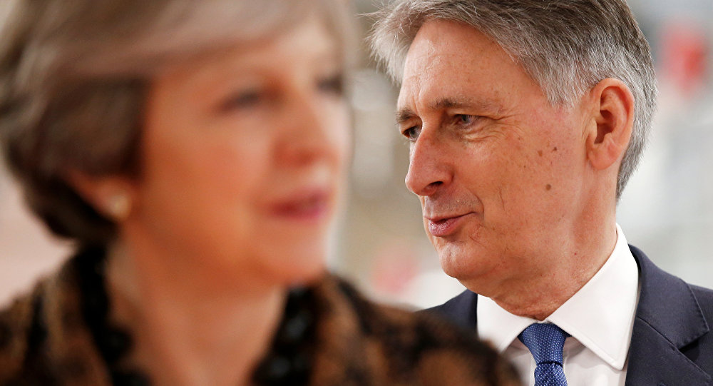 Britain's Prime Minister Theresa May and Chancellor of the Exchequer Philip Hammond visit an engineering training facility in the West Midlands, November 20, 2017.