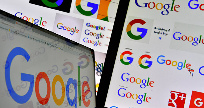 A picture taken on November 20, 2017 shows logos of US multinational technology company Google displayed on computers' screens
