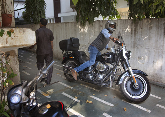 An Indian man parks his Harley Davidson Fat Boy motorcycle in New Delhi, India, Wednesday, March 1, 2017