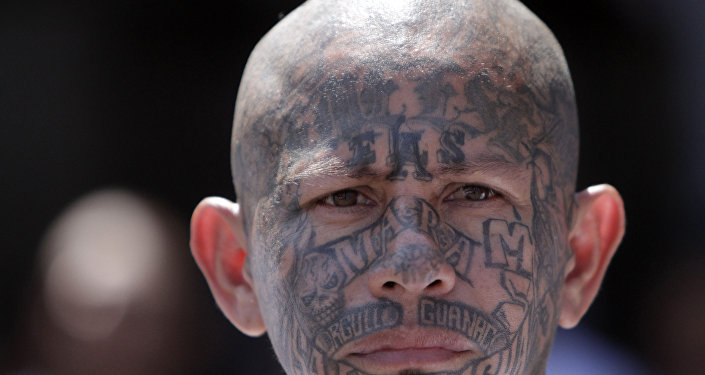 In this March 26, 2012 photo, an inmate belonging to the Mara Salvatrucha or MS-13 gang stands inside the prison in Ciudad Barrios, El Salvador. Six months after El Salvador brokered an historic truce between two rival gangs to curb the nation's daunting homicide rate, officials are split over whether the truce actually works. The gangs, which also operate in Guatemala and Honduras, are seeking truce talks in those countries as well.