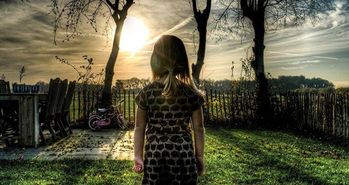 Girl standing in a garden