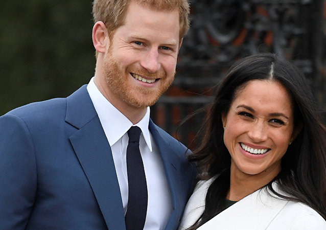 Britain's Prince Harry poses with Meghan Markle in the Sunken Garden of Kensington Palace, London, Britain, November 27, 2017