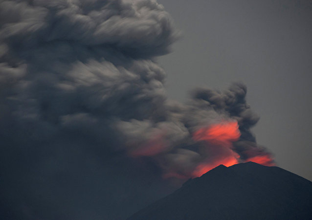 Light from lava inside the crater is reflected off volcanic ash from Mount Agung, as seen from Jemeluk Beach, Karangasem, Bali, Indonesia November 28, 2017 in this photo taken by Antara Foto. Picture taken November 28, 2017