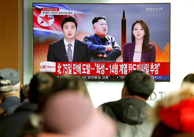 People watch a TV broadcasting a news report on North Korea firing what appeared to be an intercontinental ballistic missile (ICBM) that landed close to Japan, in Seoul, South Korea, November 29, 2017