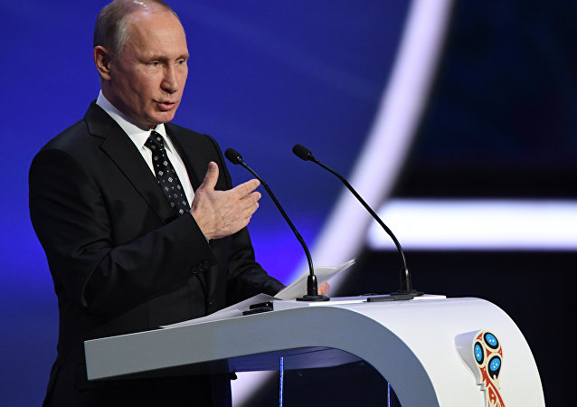 Russian President Vladimir Putin delivers a speech ahead of the 2018 FIFA World Cup football tournament final draw at the State Kremlin Palace in Moscow