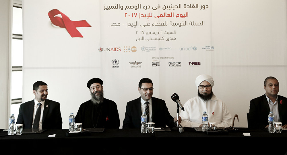 In this Saturday, Dec. 2, 2017 photo, from left to right UNAIDS country manager Ahmed Khamis, Christian father Boulos Soror, Dr. Walid Kamal, Islamic scholar and Sheik Ali al-Jifri, and Tabah Foundation member Mohammed Shahin, prepare for an even part of the World AIDS Day 2017 national advocacy campaign at a hotel, in Cairo, Egypt