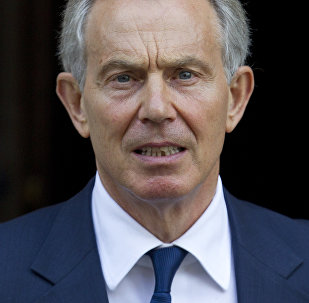 This is a Monday, May 28, 2012 file picture, of former British Prime Minister Tony Blair leaves the High Court in London.