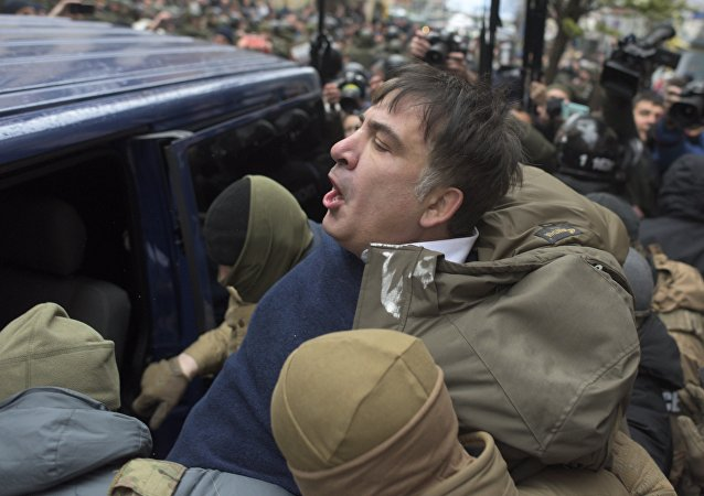 Ukrainian Security Service officers detain Mikheil Saakashvili at his house in Kiev, Ukraine, Tuesday, Dec. 5, 2017
