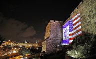 Giant US flag screened alongside Israel's national flag by the Jerusalem municipality on the walls of the old city