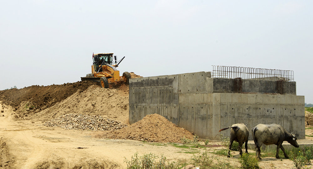 In this photograph taken on June 14, 2017, Indian labourers work at the construction area of the new railway in Janakpur, some 300km south of Kathmandu