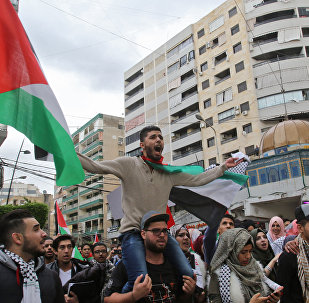 Palestinian students waving the national Palestinian flag and a model of Jerusalem's Dome of the Rock mosque protest in the streets of the southern Lebanese port city of Sidon on December 7, 2017 against US President Donald Trump's recognition of Jerusalem as Israel's capital