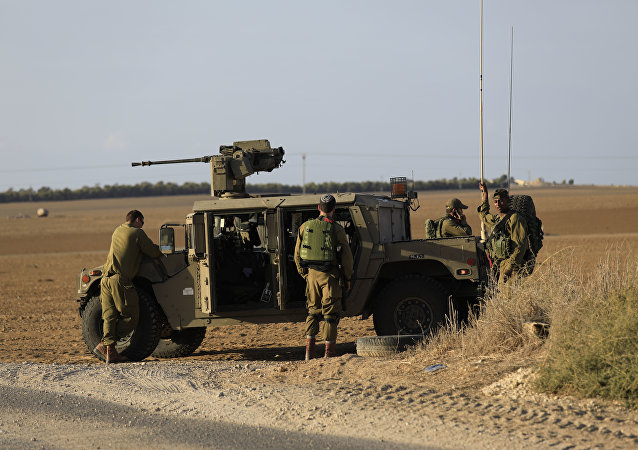 Israeli soldiers stand near the border with Gaza. (File)