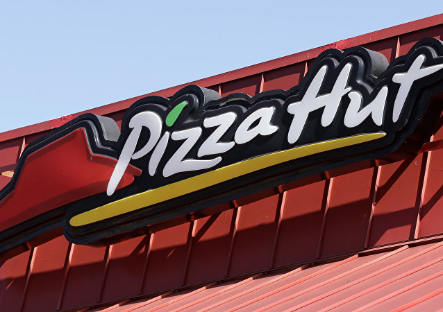 This Tuesday, Jan. 24, 2017, photo shows a Pizza Hut sign at a restaurant in Miami.