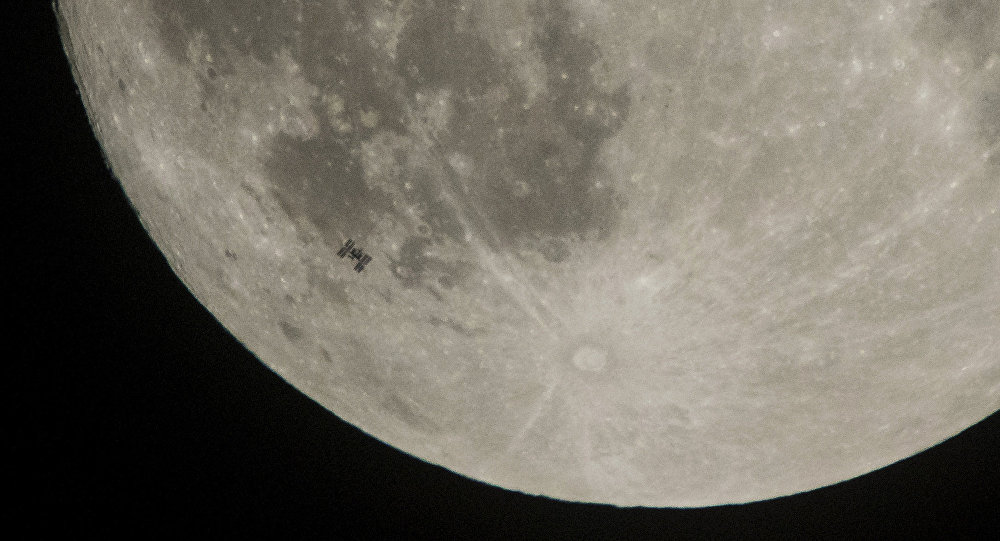 The International Space Station, with a crew of six onboard, is seen in silhouette as it transits the Moon on Saturday, Dec. 2, 2017, in Manchester Township, York County, Pa