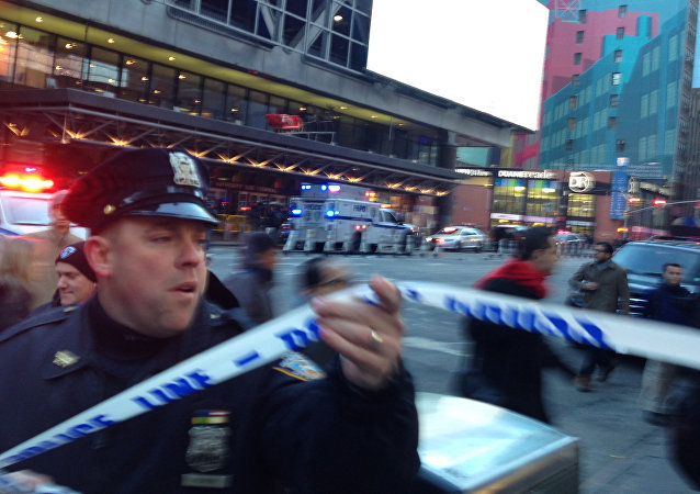 Police respond to a report of an explosion near Times Square on Monday, Dec. 11, 2017, in New York