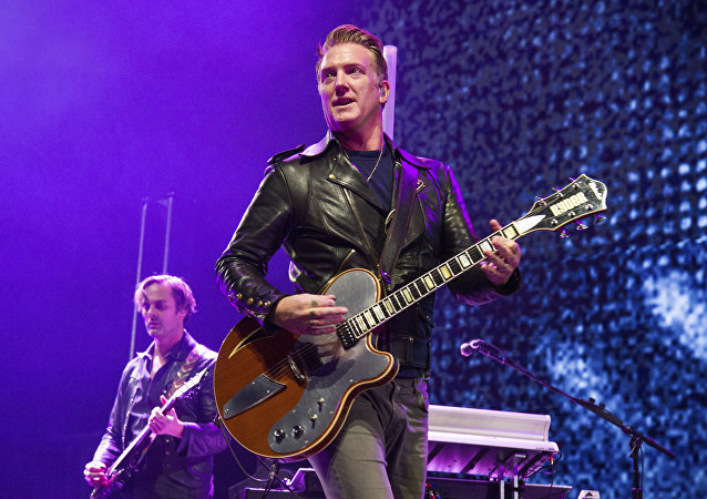 Josh Homme of Queens of the Stone Age performs at the 2017 KROQ Almost Acoustic Christmas at The Forum on Saturday, Dec. 9, 2017, in Inglewood, Calif.