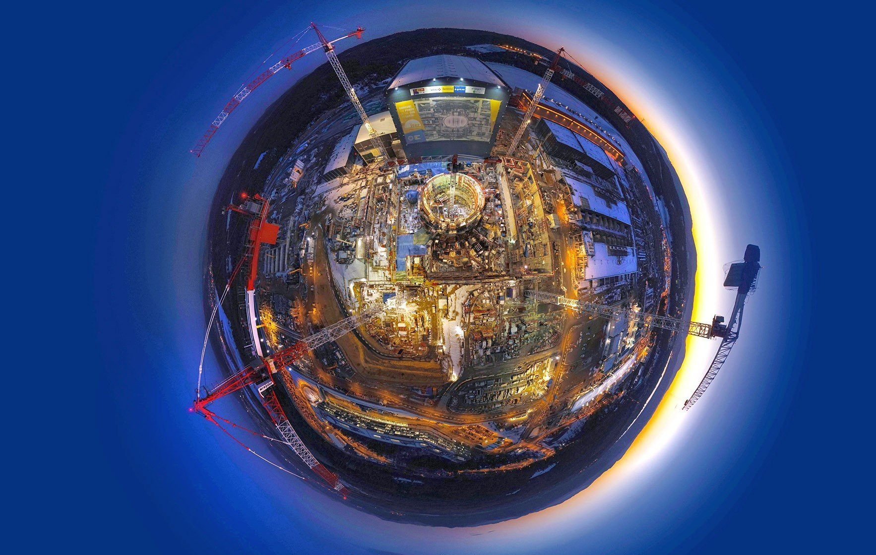 Circular lens view of the construction of the ITER facility.