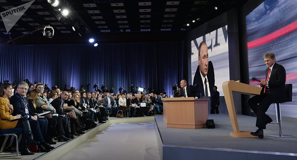 December 17, 2015. Russian President Vladimir Putin at the 11th annual news conference at the World Trade Center on Krasnaya Presnya. Right: Presidential Press Secretary Dmitry Peskov