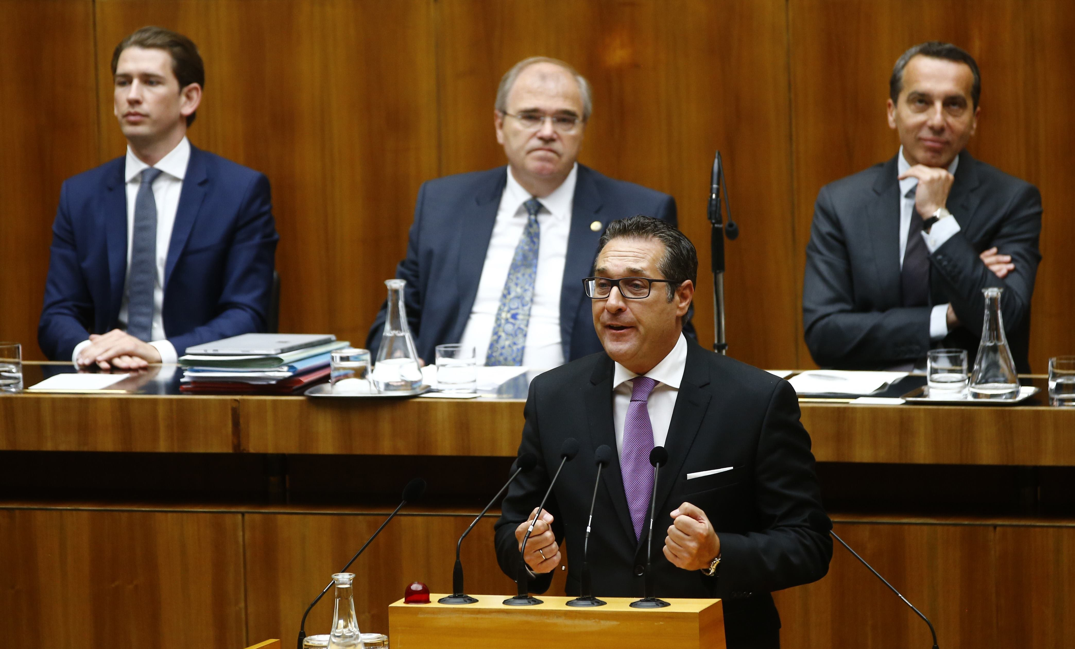 Head of Austrian Freedom Party (FPOe) Heinz-Christian Strache delivers a speech in front of Austria's Foreign Minister Sebastian Kurz, Justice Minister Wolfgang Brandstetter and Chancellor Christian Kern (L-R) during a session of the parliament in Vienna, Austria, May 16, 2017.