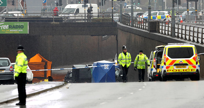 Police and emergency services are seen working at the scene of a multiple car crash on Lee Bank Middleway in central Birmingham, Britain, December 17, 2017