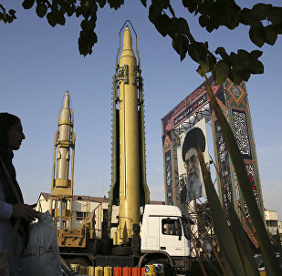 a Ghadr-H missile, center, a solid-fuel surface-to-surface Sejjil missile and a portrait of the Supreme Leader Ayatollah Ali Khamenei are displayed at Baharestan Square in Tehran, Iran