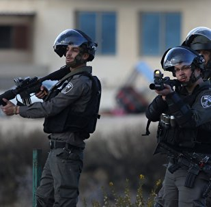 Israeli soldiers during clashes with protesters in Palestine against the decision to recognize Jerusalem as the capital of Israel