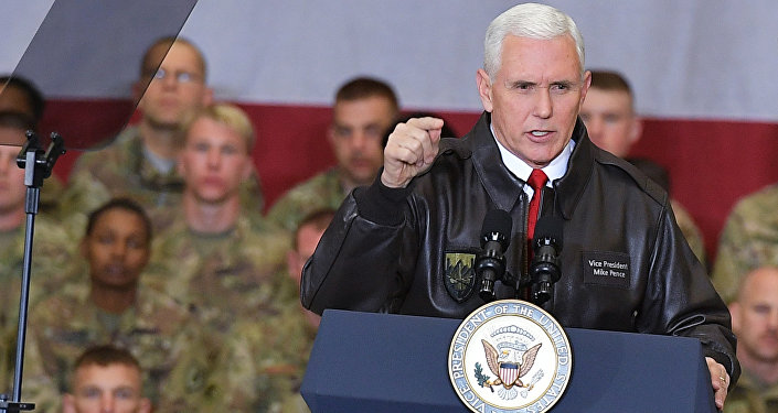 U.S. Vice President Mike Pence speaks to troops in a hangar at Bagram Air Base in Afghanistan on Thursday, Dec. 21, 2017.