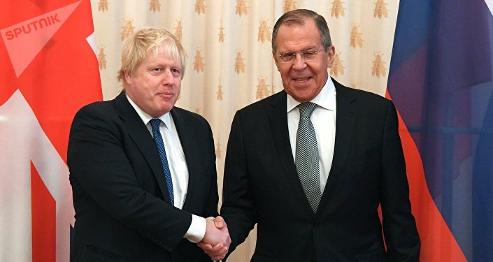 Russian Foreign Minister Sergei Lavrov, right, and British Foreign Secretary Boris Johnson during the meeting