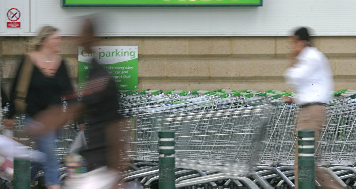Shoppers use the entrance of the Asda supermarket (File)