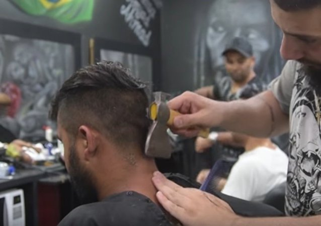 Refugee Barber Cuts His Clients Hair With an Axe